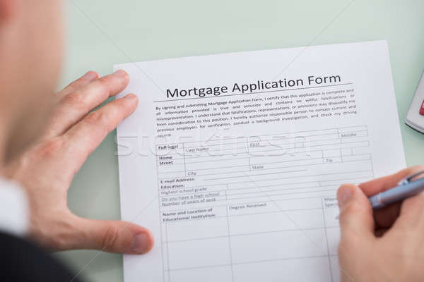Person Hand Over Mortgage Application Form Stock photo © AndreyPopov