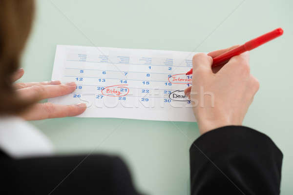 Businesswoman Hand Setting Important Date On Calendar Stock photo © AndreyPopov