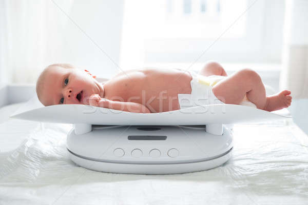 Weighting Baby Girl On Scale Stock photo © AndreyPopov