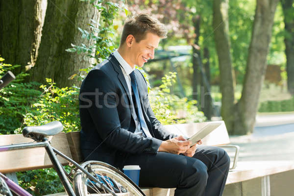 Businessman Sitting On Bench Using Digital Tablet Stock photo © AndreyPopov