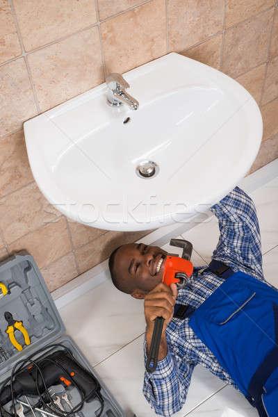 Plumber Fixing Sink In Bathroom Stock photo © AndreyPopov