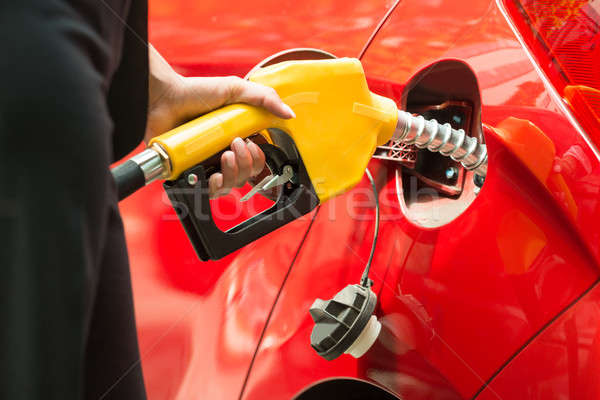 Close-up Of Businesswoman's Hand Refueling Car's Tank Stock photo © AndreyPopov