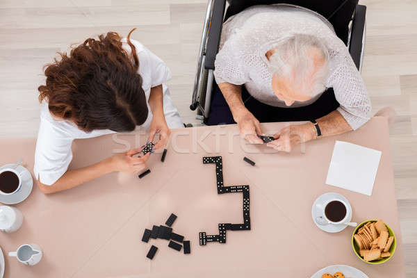 Elder Woman Playing Domino Game With Her Nurse Stock photo © AndreyPopov