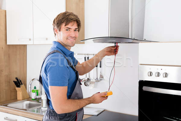 Repairman Checking Kitchen Extractor Filter Stock photo © AndreyPopov