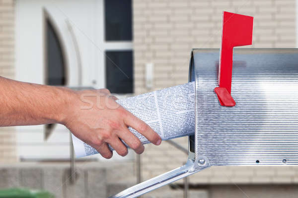 Person Hand Removing Newspaper From Mailbox Stock photo © AndreyPopov