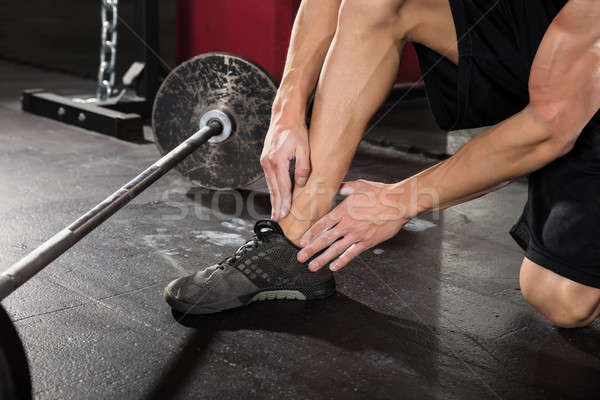 Man enkel pijn lijden oefening Stockfoto © AndreyPopov