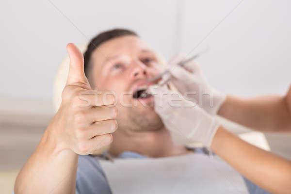 Man Showing Thumb Up Sign While Having Dental Checkup Stock photo © AndreyPopov