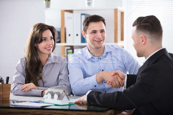 Couple Shaking Hands With Real Estate Advisor Stock photo © AndreyPopov