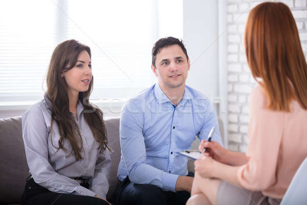 Psychologist Sitting With Couple Stock photo © AndreyPopov
