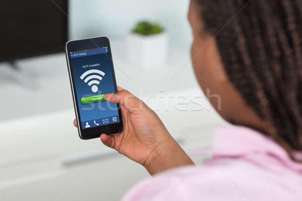 Girl Connecting Wifi On Smart Phone Stock photo © AndreyPopov