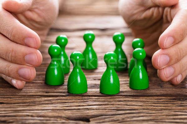 Személy zöld személyek közelkép fa asztal üzlet Stock fotó © AndreyPopov