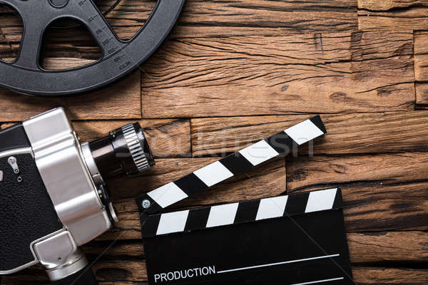 Movie Camera With Film Reel And Clapper Board On Wood Stock photo © AndreyPopov