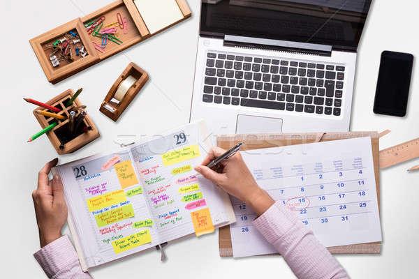 Ver empresário escrita programar diário laptop Foto stock © AndreyPopov