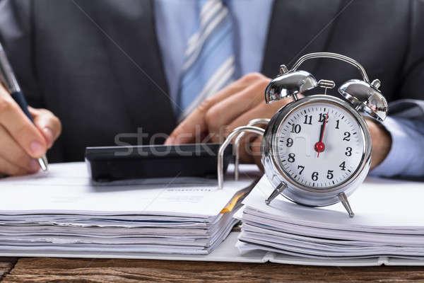 Imprenditore fattura sveglia documenti tavola business Foto d'archivio © AndreyPopov