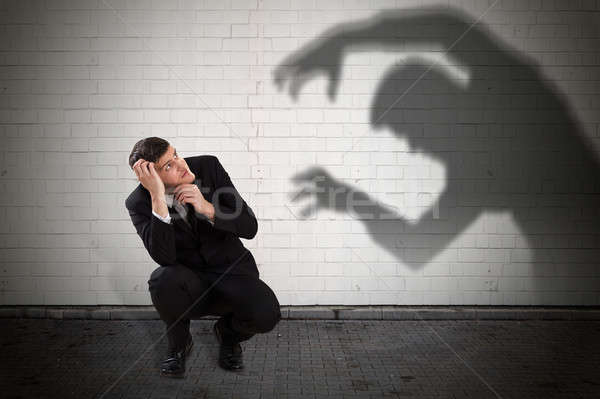 Işadamı şeytan gölge genç düşen Stok fotoğraf © AndreyPopov