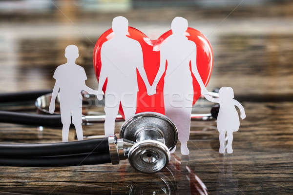 Close-up Of Family Cut Out And Red Heart Stock photo © AndreyPopov