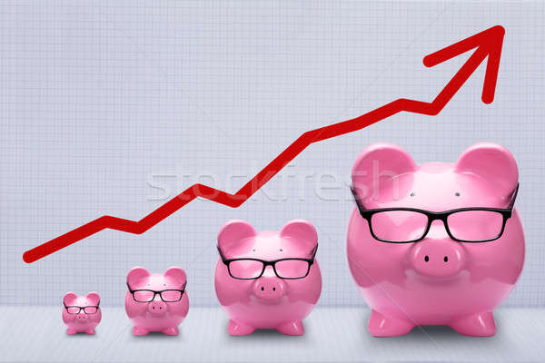 Increasing Size Of Piggy Banks Kept In A Row Stock photo © AndreyPopov
