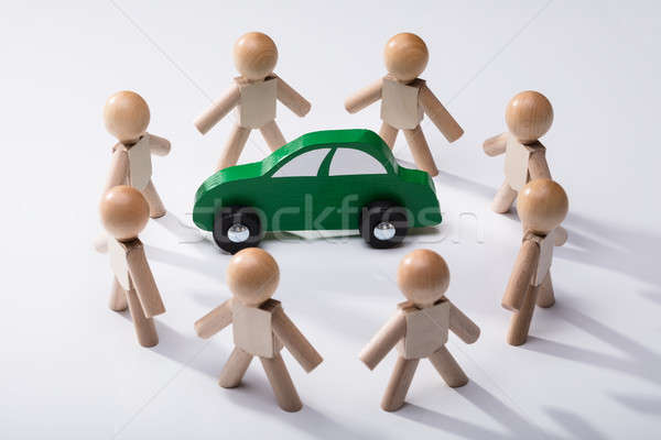 Green Car Surrounded By Human Figures Stock photo © AndreyPopov