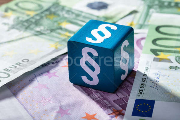 Paragraph Symbol On Blue Block Over The Euro Notes Stock photo © AndreyPopov
