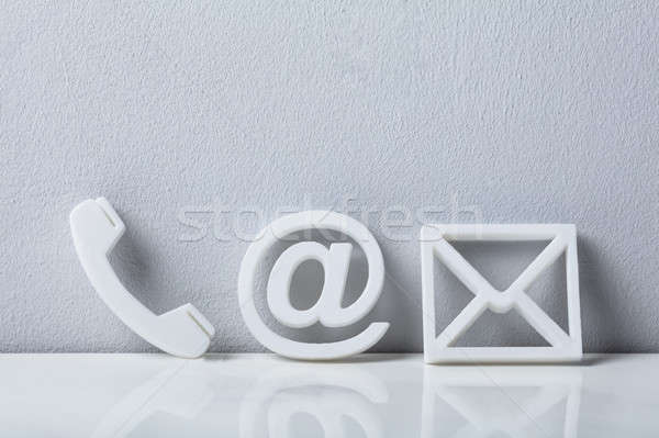 Close-up Of A Phone, Email and Post Icons Stock photo © AndreyPopov