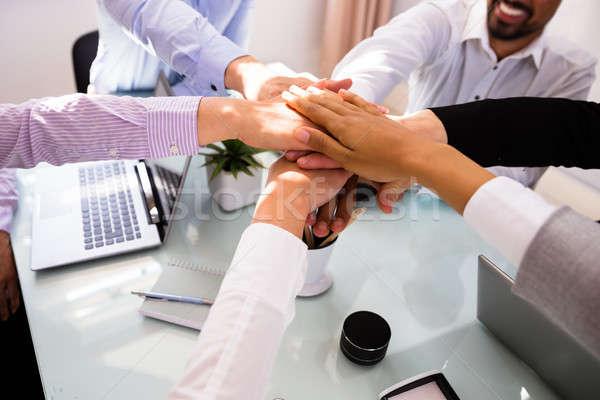 Csoport üzletemberek kezek asztal iroda kéz Stock fotó © AndreyPopov