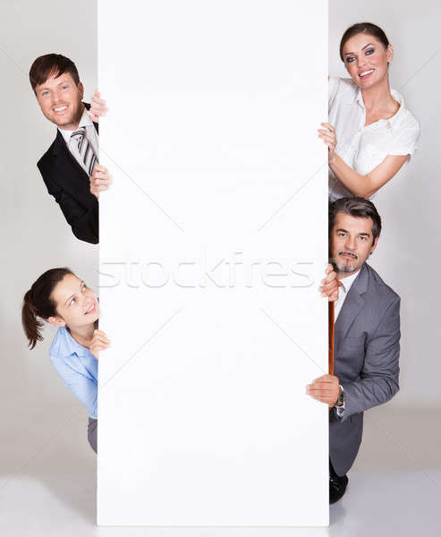 Businesspeople Holding Placard Stock photo © AndreyPopov