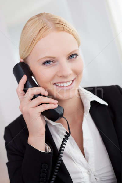 Beautiful businesswomen talking on the phone Stock photo © AndreyPopov