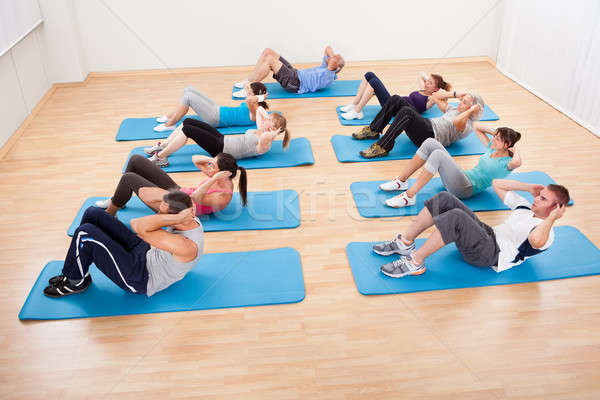 Group of people working out in a gym Stock photo © AndreyPopov
