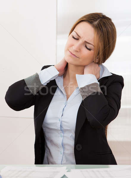Young Attractive Businesswoman Suffer From Neck Pain Stock photo © AndreyPopov