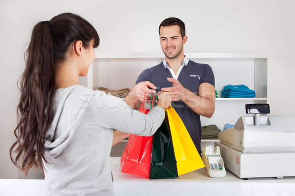 Customer buying clothes in shop Stock photo © AndreyPopov