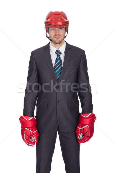 Competitive businessman wearing hockey equipment Stock photo © AndreyPopov