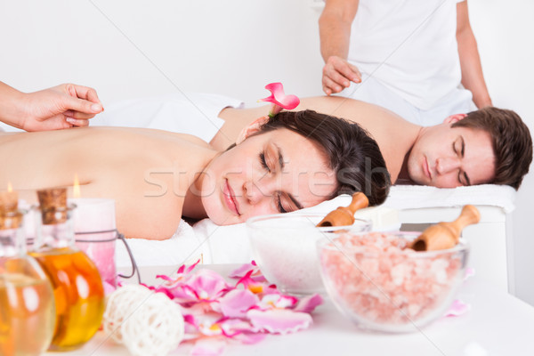 Couple Receiving An Acupuncture Treatment Stock photo © AndreyPopov