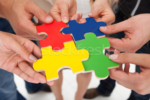 Stock photo: Businesspeople Joining Puzzle Pieces