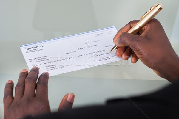 Affaires remplissage chèque bureau argent Photo stock © AndreyPopov