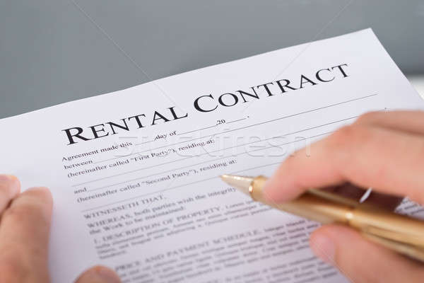 Hand filling rental contract Stock photo © AndreyPopov