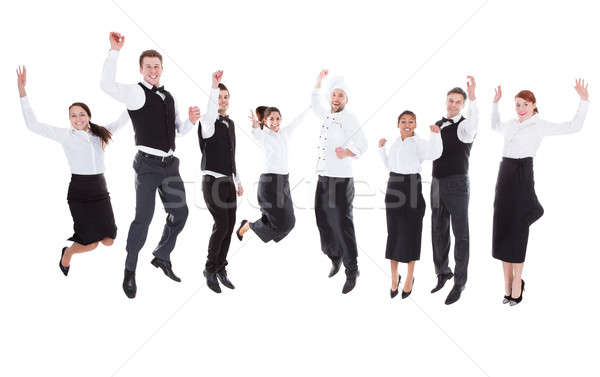 Stock photo: Waiters and waitresses jumping