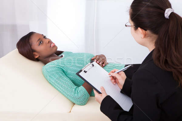 Happy Patient Talking To Psychologist Stock photo © AndreyPopov