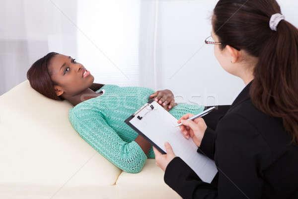 Boldog beteg beszél pszichológus női ágy Stock fotó © AndreyPopov