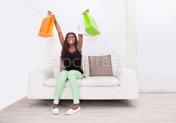 Woman Carrying Shopping Bags In Living Room Stock photo © AndreyPopov
