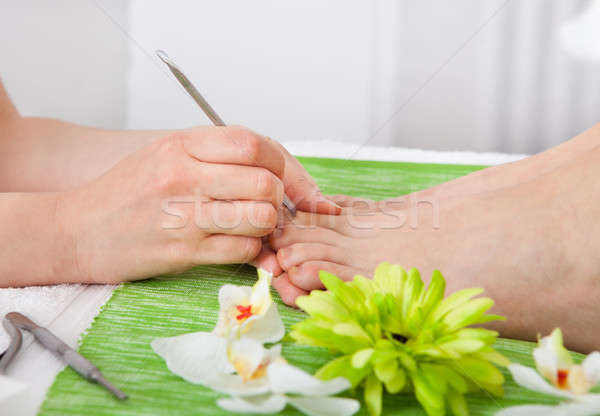 Beautician Giving Pedicure Treatment Stock photo © AndreyPopov