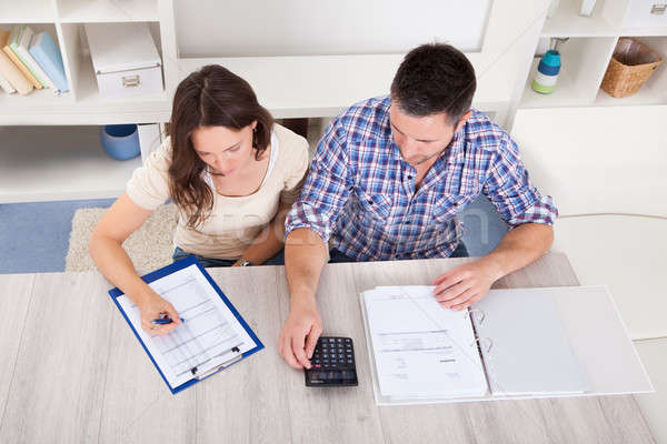 Couple Calculating Bills Stock photo © AndreyPopov