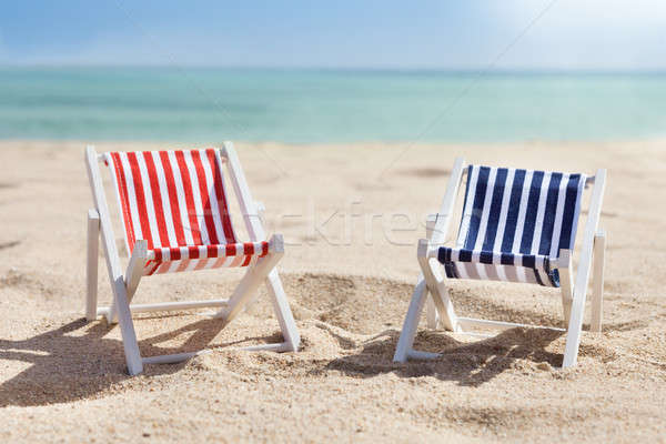 Two Deckchairs On Beach Stock photo © AndreyPopov