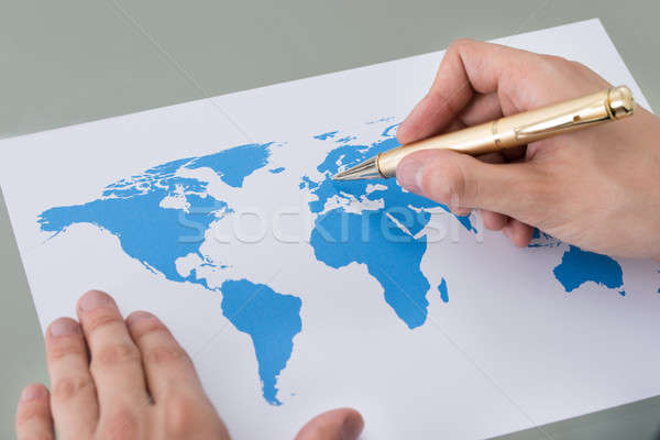 Businessman Marking Places On World Map Stock photo © AndreyPopov