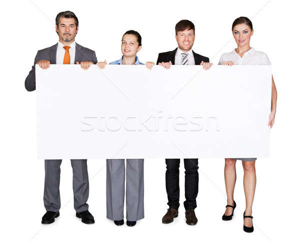 Confident Businesspeople Displaying Large Billboard Stock photo © AndreyPopov