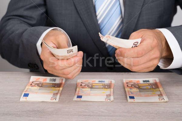 Businessman Counting Money Stock photo © AndreyPopov