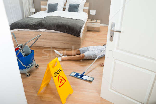 Maid Had Accident While Cleaning Hotel Room Stock photo © AndreyPopov