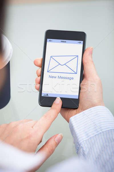 üzletember tart mobiltelefon új üzenet felirat Stock fotó © AndreyPopov