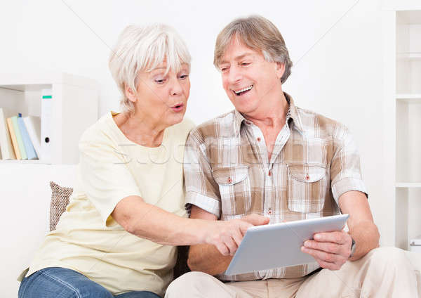 Stock photo: Senior Couple Using Digital Tablet