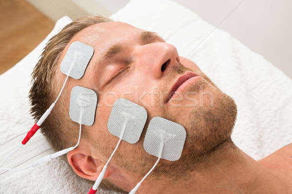 Man Closing Eyes With Electrodes On Face Stock photo © AndreyPopov