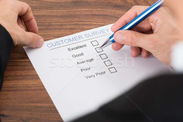 Person's Hand Filling Customer Survey Stock photo © AndreyPopov